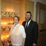 A female resident standing with a Rabbi.