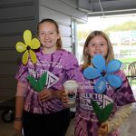 2 young women wearing Walk to End Alzheimer's shirts.
